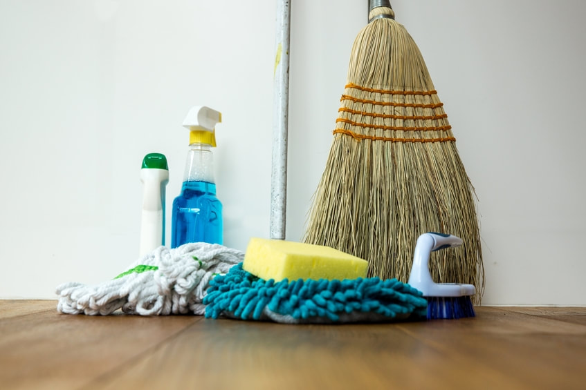 Broom, sponges, mops, and cleaning chemicals.