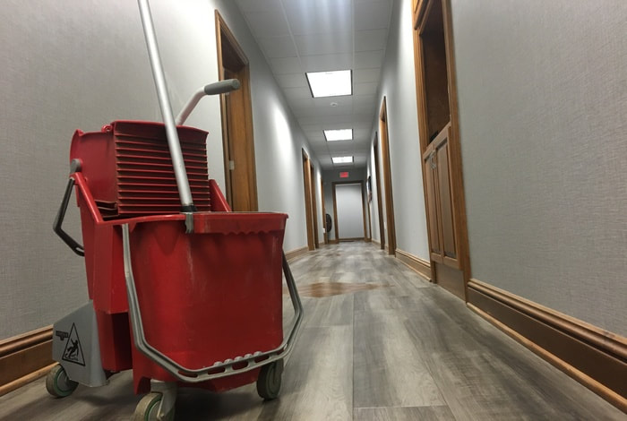 Cleaning floors in a modern office.